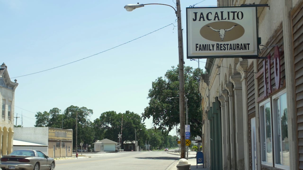 Street sign for the Jacalito Famly Restaurant in Strong City