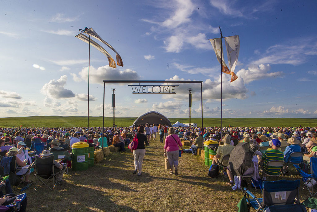 Attendees walk under the welcome sign during the 10th Annual Symphony in the Flint Hills at the Tallgrass Prairie National Preserve in Chase County. Photo by Kelly Glasscock