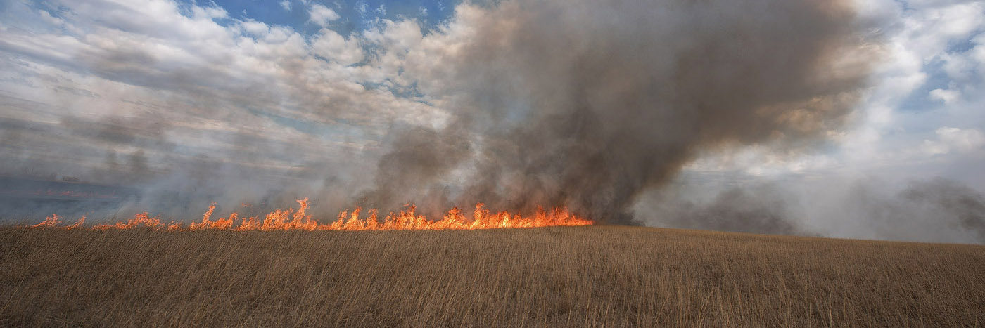 photo of controlled prairie burn and smoke