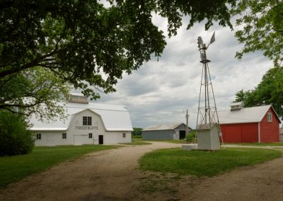 White barn, windmill and granary