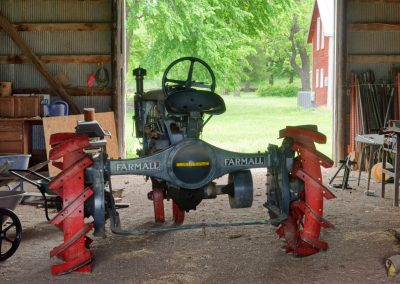 Antique Farmall tractor, gray with red wheels
