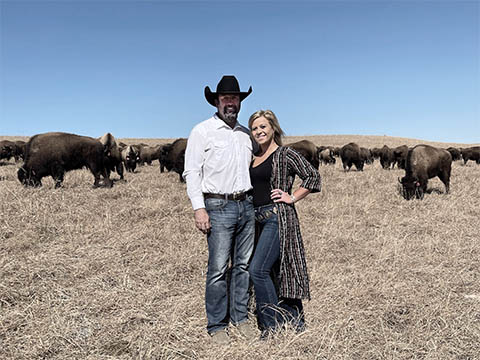 Portrait of the Harshmans with cattle