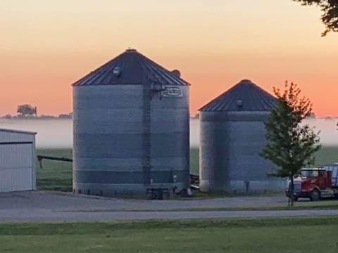 Grain silos at sunset