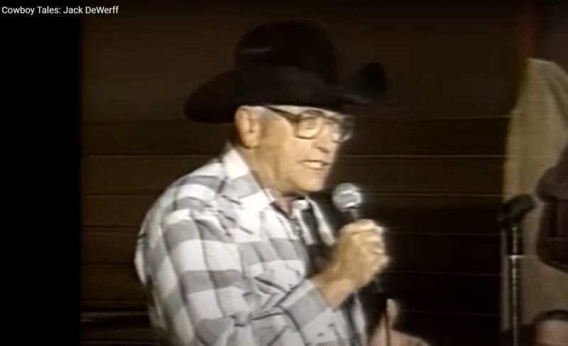 Jack DeWerff holding a microphone