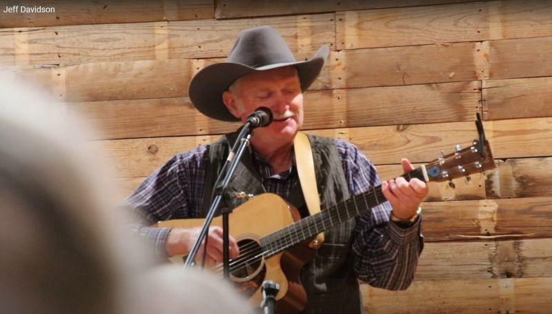 Jeff Davidson, singing and playing guitar